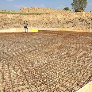 Steel reinforcement of the foundation for the construction of round slurry storage tanks